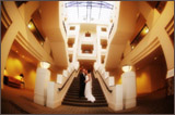 photo of a bride and groom kissing on stairs
