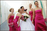 photo of four bridesmaids in pink surrounding a bride