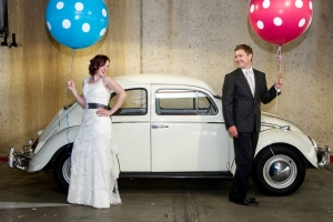 Bride and Groom next to VW Beetle