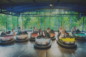A bridal party driving dodgem cars